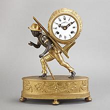 German Gilt and Patinated-Metal Blackamoor-Form Clock