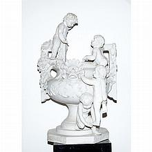 Neoclassical Style Putti Decorated Garden Urn   Height 42 inches, width 29 inches.