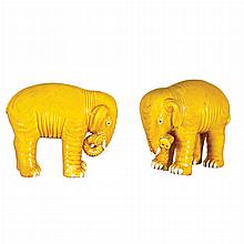 Two Similar Yellow Glazed Porcelain Elephants