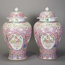 Two Similar Chinese Famille Rose Glazed Porcelain Covered Vases