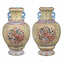 Two Similar Chinese Famille Rose Glazed Porcelain Reticulated Vases