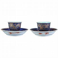 Two Similar Chinese Blue and Gilt Porcelain Cups and Saucers