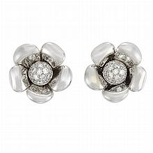 Pair of White Gold and Diamond Flower Earclips, by Marvin Schluger