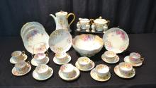 FLORAL HAND PAINTED TEA SERVICE CONSISTING OF