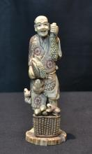 MAMMOTH IVORY MAN WITH FROGS, FISH  & BASKET OF