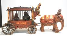 ELEPHANT PULLING CIRCUS WAGON WITH CLOWN