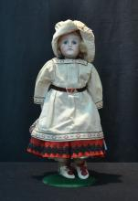 BISQUE SHOULDER HEAD DOLL WITH PAPERWEIGHT
