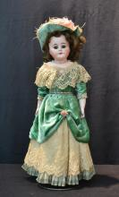 BISQUE SHOULDER HEAD DOLL WITH LARGE BROWN