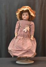 GERMAN BISQUE HEAD DOLL WITH BROWN SLEEP EYES