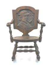 OAK ARM CHAIR ROCKER WITH CARVED MAN WIITH PIPE