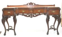 SERPENTINE HEAVILY CARVED INLAID SIDEBOARD