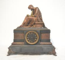 BRONZE WOMAN RECLINING ATOP MARBLE CLOCK