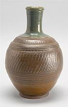 BIZEN POTTERY TOKKURI In ovoid form with geometric incised design beneath a green-glazed neck. Height 9.5