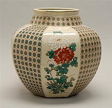AO KUTANI POTTERY JAR With prunus and chrysanthemum design on a floral lattice ground. Height 9.5