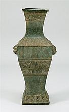 PORCELAIN VASE In squared baluster form with bronze-like glaze and archaic-style decoration. Six-character Qianlong mark on base. He...
