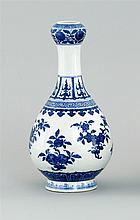 BLUE AND WHITE PORCELAIN VASE In teardrop form with garlic mount. Body decorated with fruit and flowers. Six-character Qianlong mark...