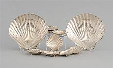 TEN PIECES OF TIFFANY & CO. STERLING SILVER HOLLOWARE All in the form of scallop shells. Includes two large serving dishes, lengths...