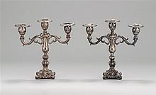 PAIR OF STERLING SILVER PERUVIAN THREE-SOCLE CANDELABRA With stepped shafts. Bases with molded fleur de lis decoration. Each marked...