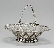 VICTORIAN STERLING SILVER BASKET William Robert Smily, maker. Body with cast foliate rim and alternating panels of pierced designs i...