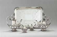 FIVE-PIECE STERLING SILVER TEA AND COFFEE SET BY WILHELM LUDWIG OF HANAU In ribbed form with floral finials, applied floral decorati...
