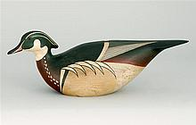 STYLIZED WOOD DUCK DRAKE DECOY By Jim Keefer of Rockport, Maine. Glass eyes. Head turned left. Distressed finish. Signed in ink on b...