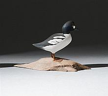 MINIATURE GOLDENEYE DRAKE By Harold Gibbs of Barrington, Rhode Island. Mounted on a driftwood base. Signed on underside of base