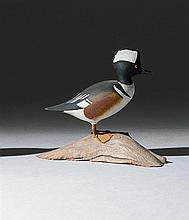 MINIATURE HOODED MERGANSER DRAKE By Harold Gibbs of Barrington, Rhode Island. Mounted on a driftwood base. Signed on underside of ba...