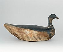 EARLY MONOMOY BRANT DECOY From Cape Cod, Massachusetts. Maker unknown. Old paint shows in-use wear. Age split. Head re-nailed but st...