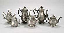 SIX ANTIQUE AMERICAN PEWTER COFFEEPOTS AND TEAPOTS A Palethorp & Connell teapot with straight line mark, a George Richardson teapot...