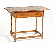 ANTIQUE AMERICAN TAVERN TABLE In pine and maple. Top with breadboard ends. Single drawer. Turned legs joined by stretcher base. Heig...