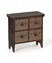 COUNTERTOP SPICE CABINET Cornice molded top over four drawers with stenciled spice labels. Mahogany knob pulls. Bootjack ends. Heigh...