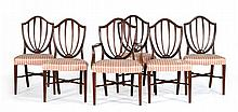 SET OF SIX CUSTOM-MADE HEPPLEWHITE-STYLE CHAIRS Five side chairs and one armchair in mahogany with shield backs and square tapered l...