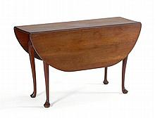 ANTIQUE AMERICAN QUEEN ANNE DROP-LEAF TABLE In cherry with nicely shaped skirt and cabriole legs ending in pad feet. Height 27.5