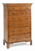 ANTIQUE AMERICAN CHIPPENDALE TALL CHEST In maple with chestnut secondary woods. Six graduated drawers, the top drawer simulating two...