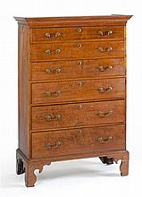 ANTIQUE AMERICAN CHIPPENDALE TALL CHEST In wavy cherry with six graduated drawers and nicely molded high flat bracket feet. Retains...