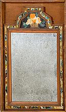 ANTIQUE COURTING MIRROR Mounted in a pine box. Reverse-painted glass crest with flower basket decoration. Mirror 15.5