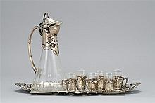 EIGHT-PIECE BRUCKMANN & SÖHNE JUGENDSTIL .800 SILVER AND GLASS CORDIAL SET With Art Nouveau foliate decoration. Silver-mounted color...