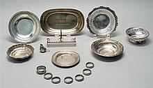 SIXTEEN PIECES OF AMERICAN AND ENGLISH HOLLOWWARE By various makers. Includes a bread tray, a tea spouter, a sugar cube holder, six...