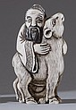 IVORY NETSUKE In the form of a sage holding a deer. Not available for international or California delivery.