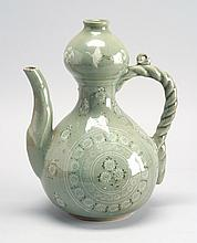 KOREAN INLAID CELADON WINE POT In double gourd form with floral design and ropework handle. Height 10
