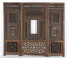 RARE THREE-PANEL HAREM SCREEN In open lattice design with two hinged doors. Base with ebony and bone inlay and engraved gilt calligr...