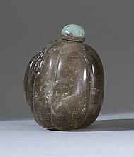 ROCK CRYSTAL SNUFF BOTTLE In fruit form with carved leaves and vines. Some dark inclusions. Height 1.75