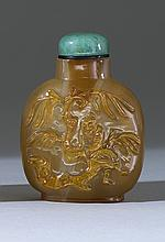 CAMEO AGATE SNUFF BOTTLE In flattened ovoid form with relief depiction of a sage seated beneath a willow tree. Height 2.25