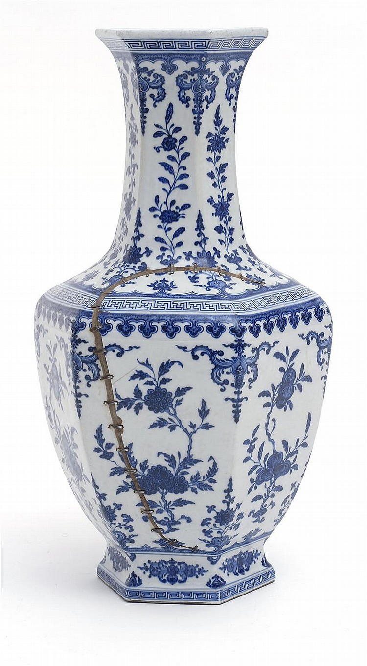 BLUE AND WHITE PORCELAIN VASE In hexagonal form with flower and fruit decoration. Rivet repair at shoulder. Height 26¾