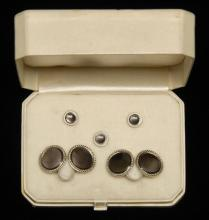 ART DECO 10KT GOLD AND MOTHER-OF-PEARL MAN'S DRESS SET A pair of cufflinks and three shirt studs. In a case for retailer Frederick L..