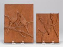 TWO RELIEF-CARVED WALNUT PANELS BY ALETHA MACY OF NANTUCKET Both depict birds on branches. Largest with carved signature on reverse...