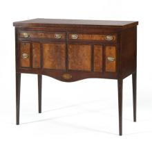 ANTIQUE AMERICAN HEPPLEWHITE SIDEBOARD In the manner of John Howard. In mahogany with inset marble top. Front edge of top with geome...