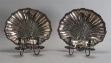 PAIR OF PRILL SILVER CO. SHELL-FORM SILVER PLATED TWO-LIGHT WALL SCONCES Each with gadrooned candle cups and drip trays on down-scro...