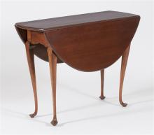 ANTIQUE AMERICAN QUEEN ANNE DROP-LEAF TABLE In cherry with D-form leaves and cabriole legs ending in delicate pad feet. Height 28.5