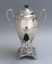 GEORGE III-STYLE SILVER PLATED HOT WATER URN Stop-gadrooned body with lift-off cover, two handles, and four slender legs ending in p...